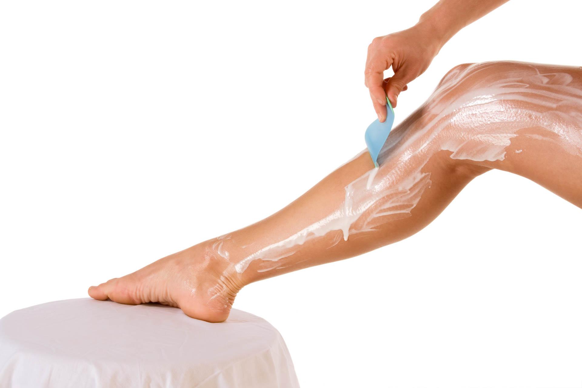 Shaving - woman removing leg hair (close up)